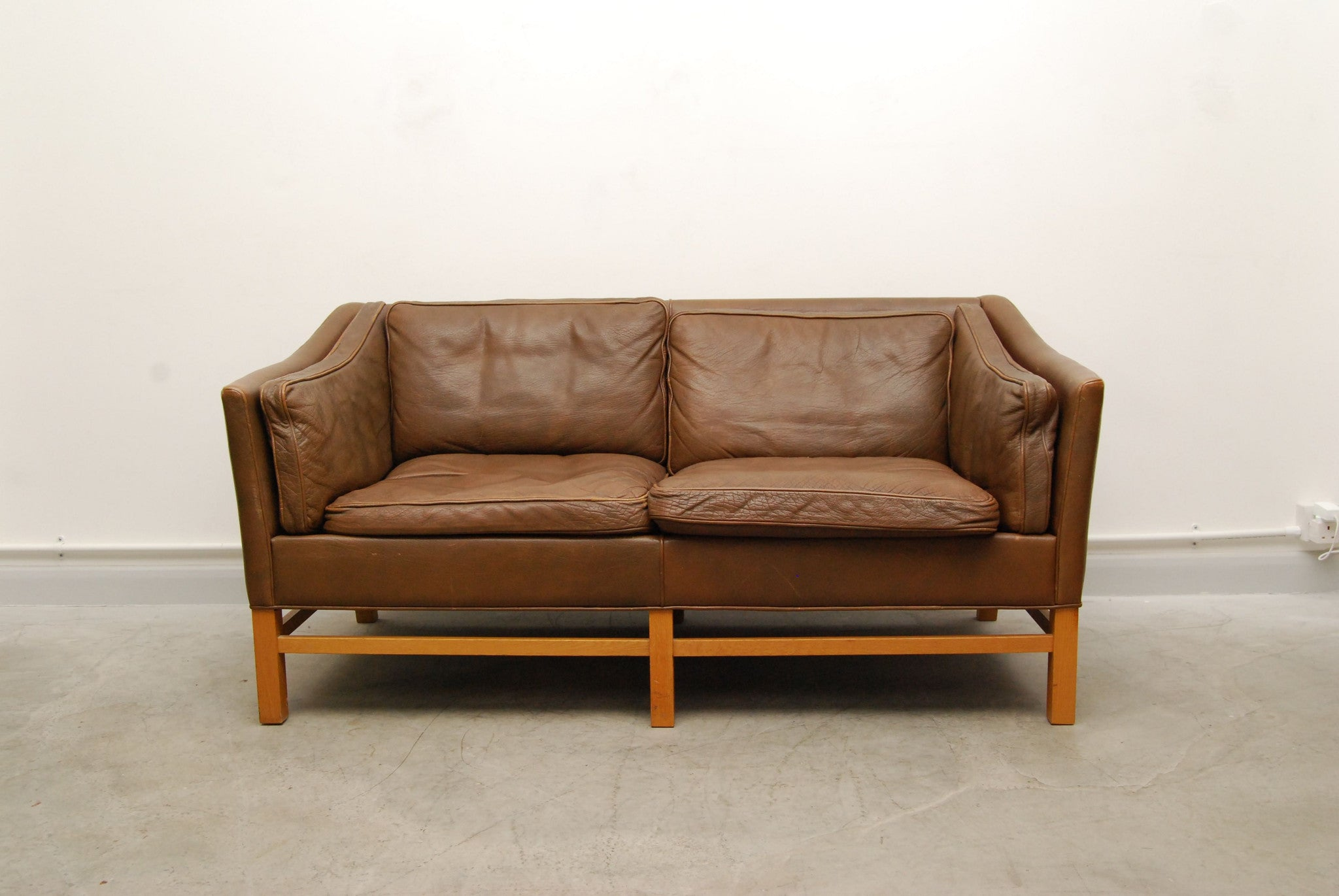 Scalloped back two seat sofa