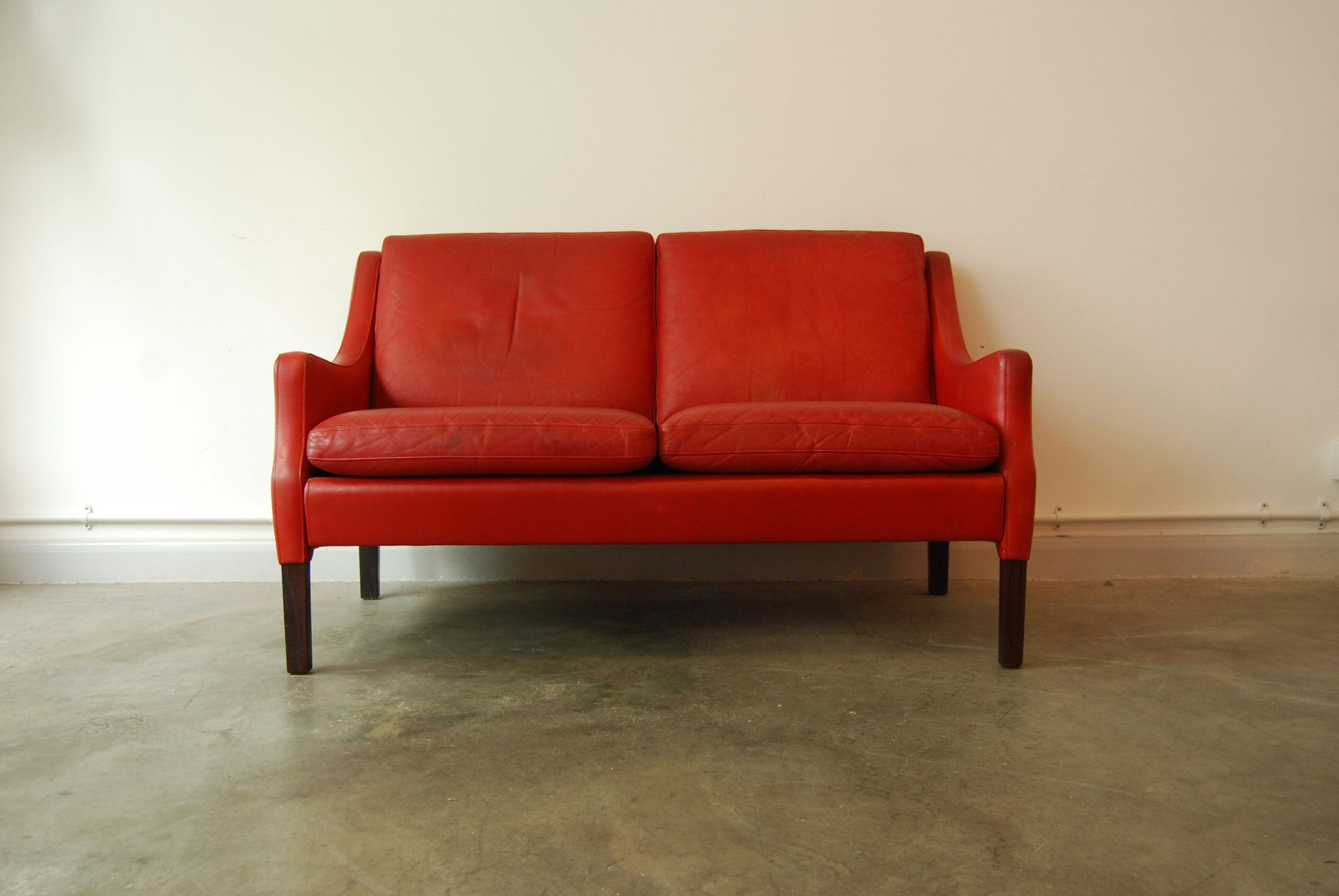 Two seat sofa in red leather