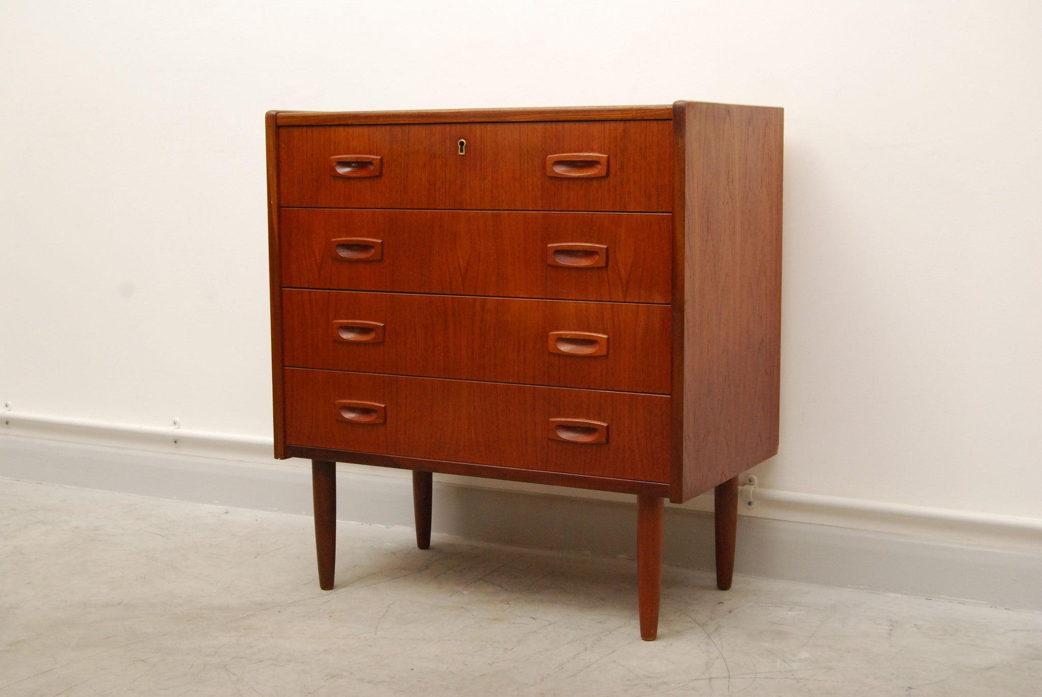 Short chest of four drawers with inset handles