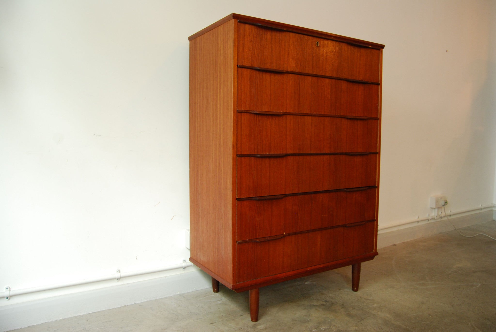 Teak chest of six drawers
