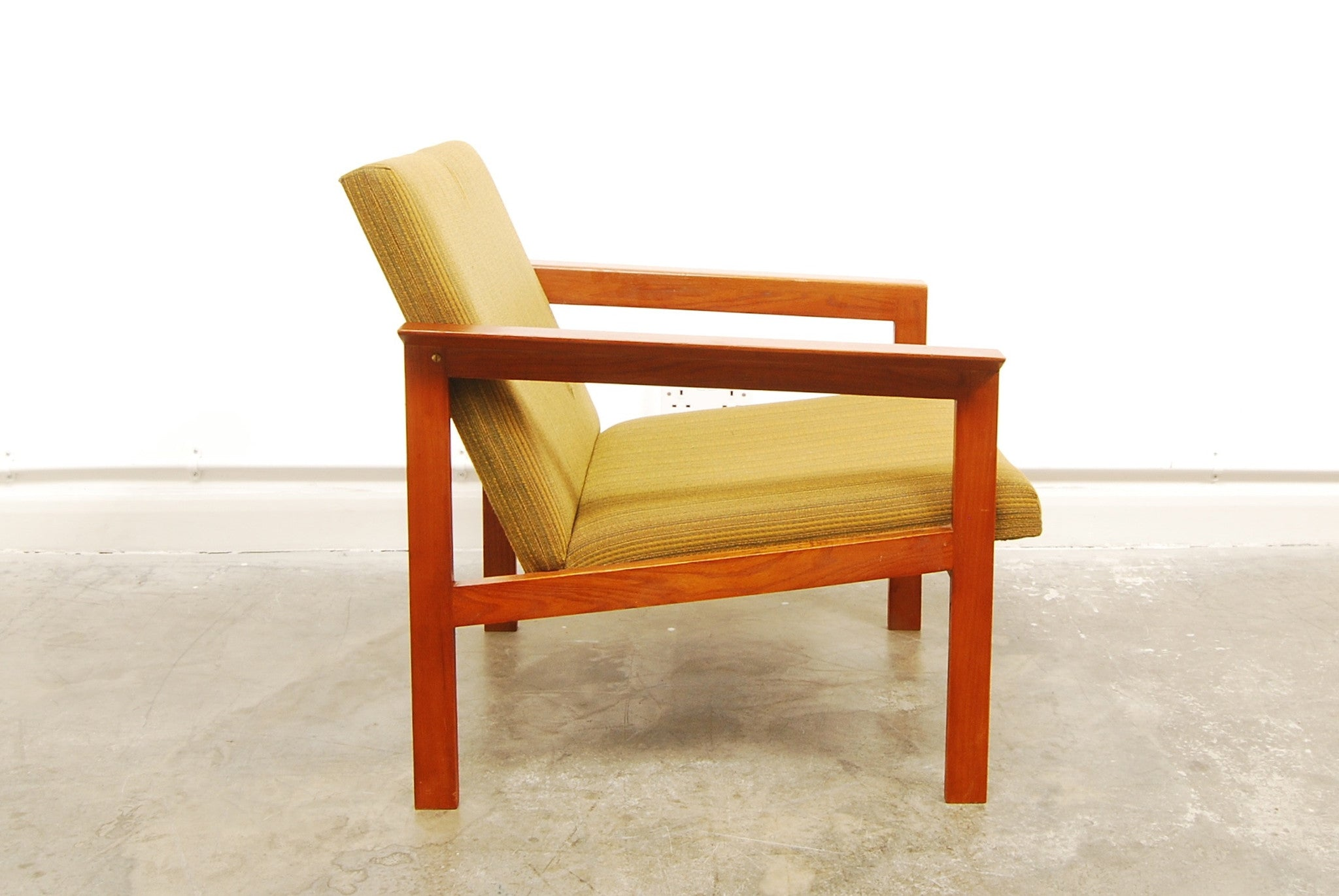 Teak framed lounge chair