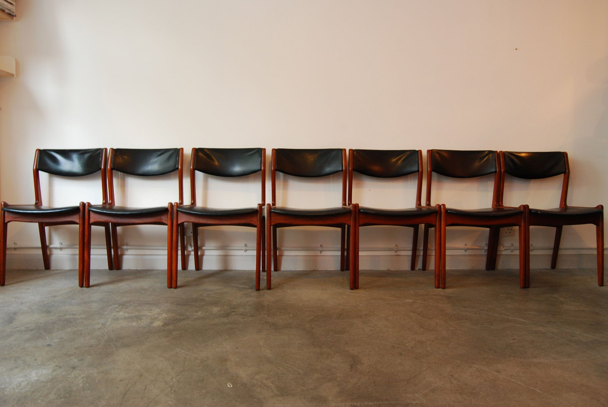 Set of seven teak dining chairs