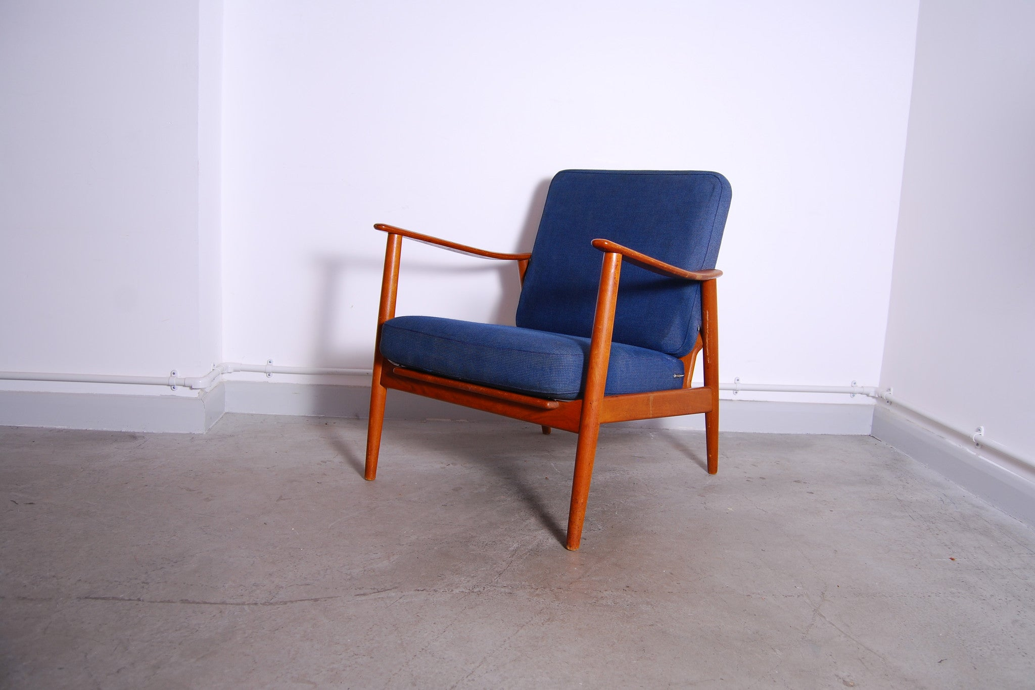 Teak lounge chair with royal blue cushions