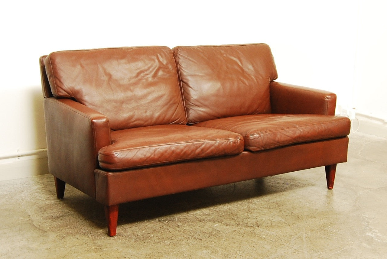 Two seat brown leather sofa