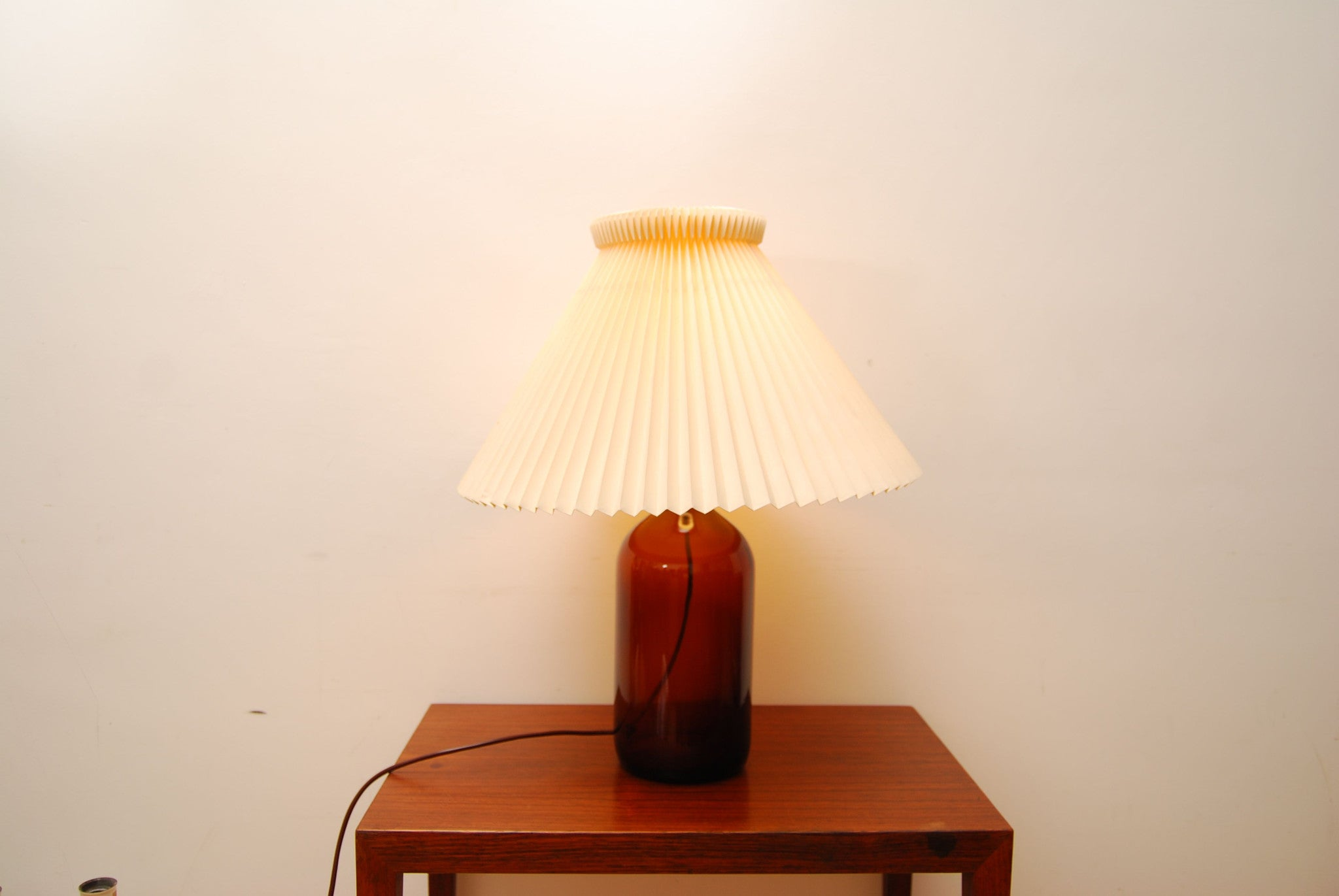 Glass bottle lamp with Le Klint shade