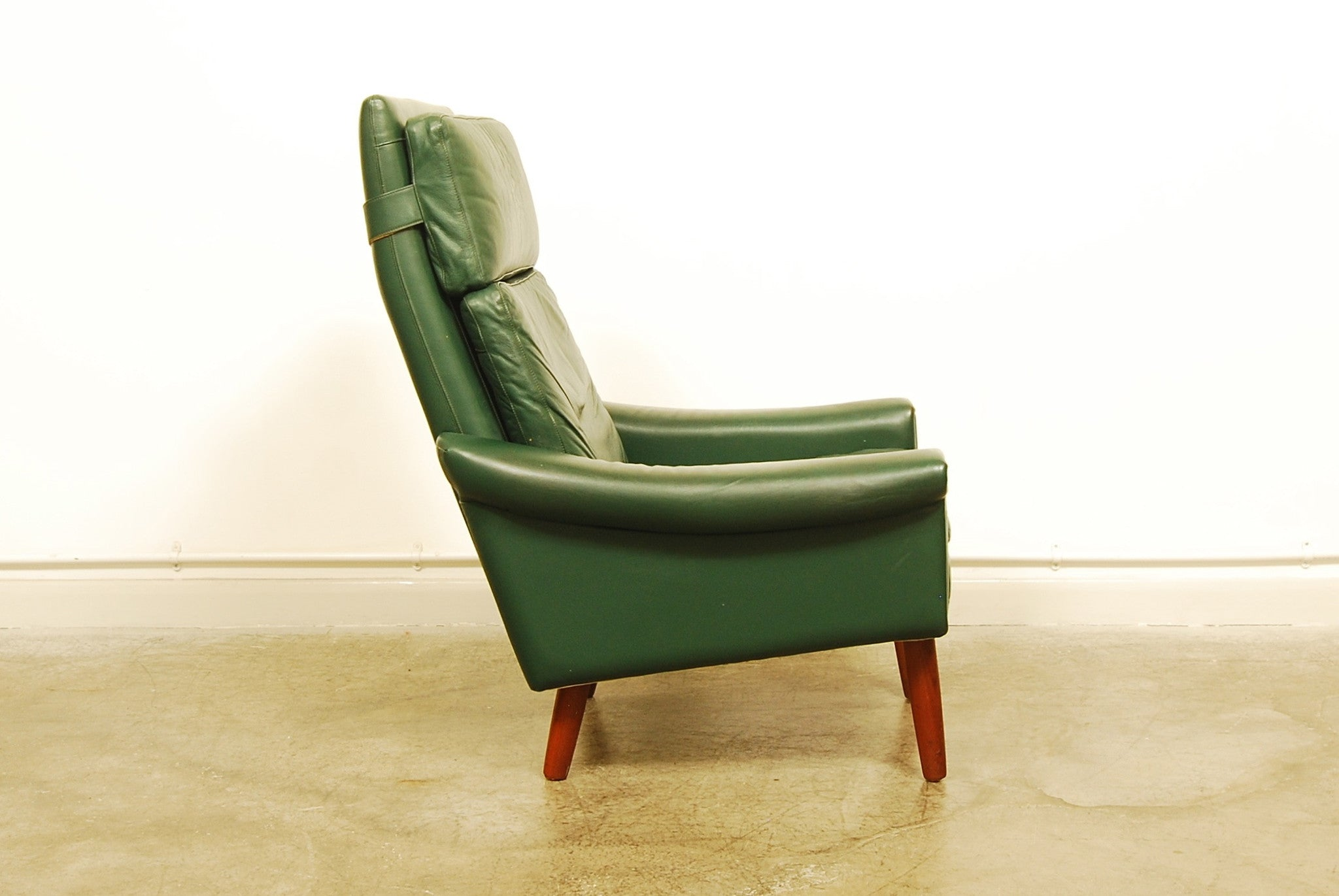 High back green leather lounge chair
