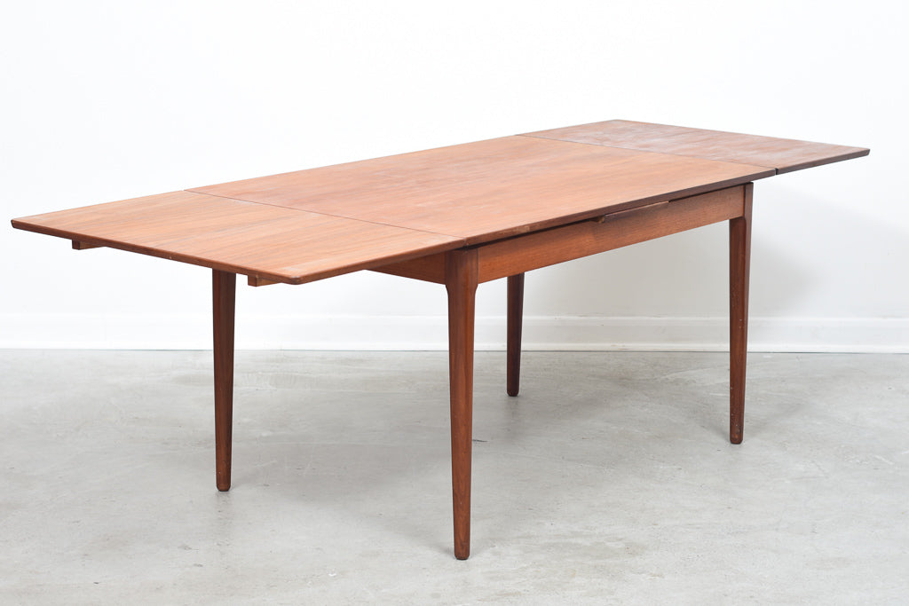 Extending teak dining table
