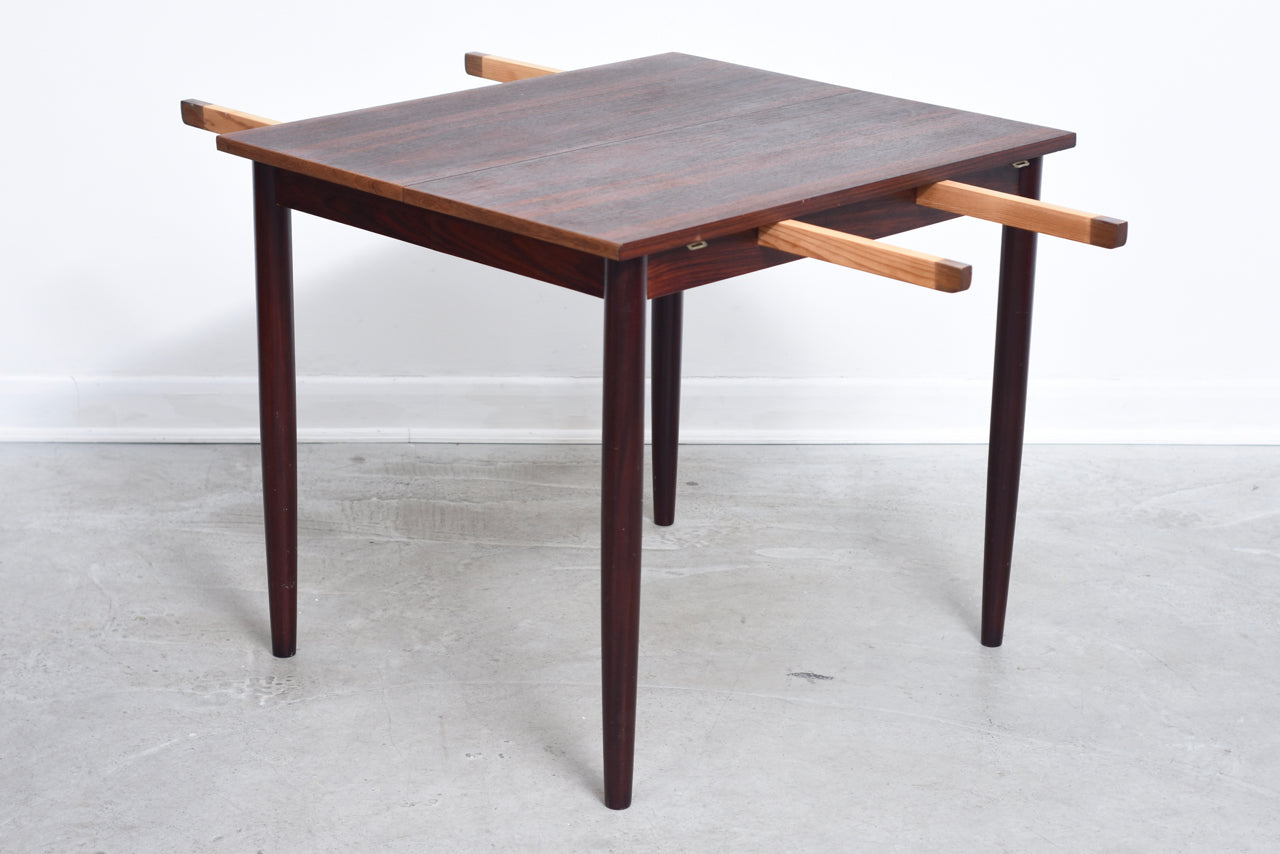 Extending dining table in rosewood