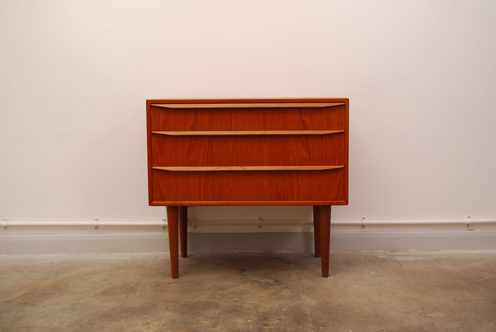 Short teak chest of drawers