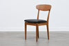 Set of four teak and oak dining chairs