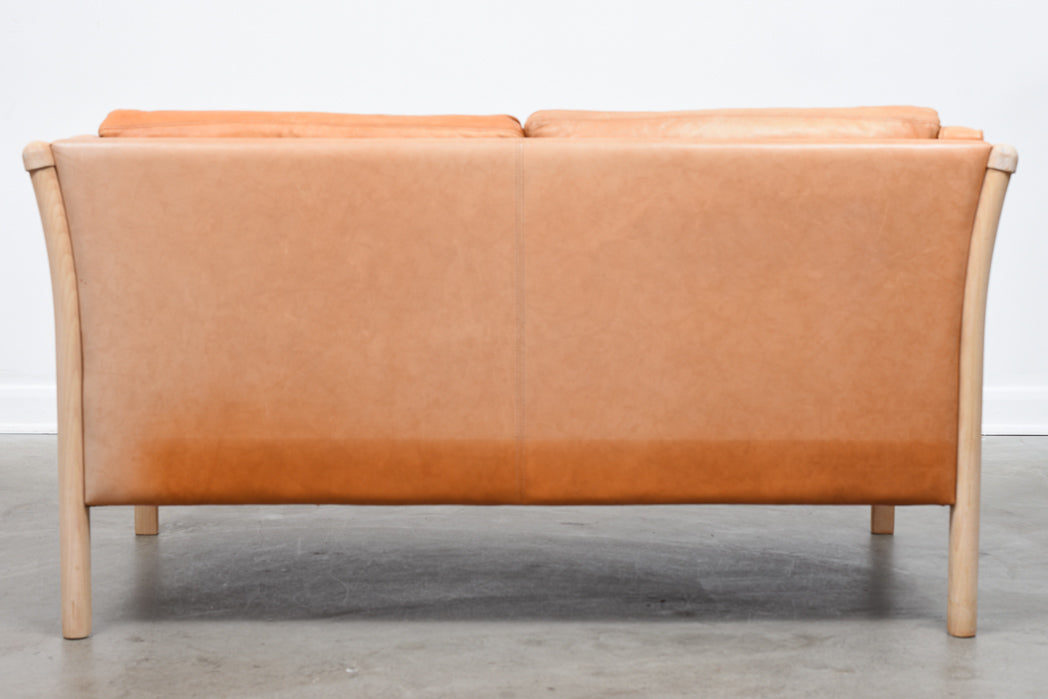 Two seat leather sofa by Stouby