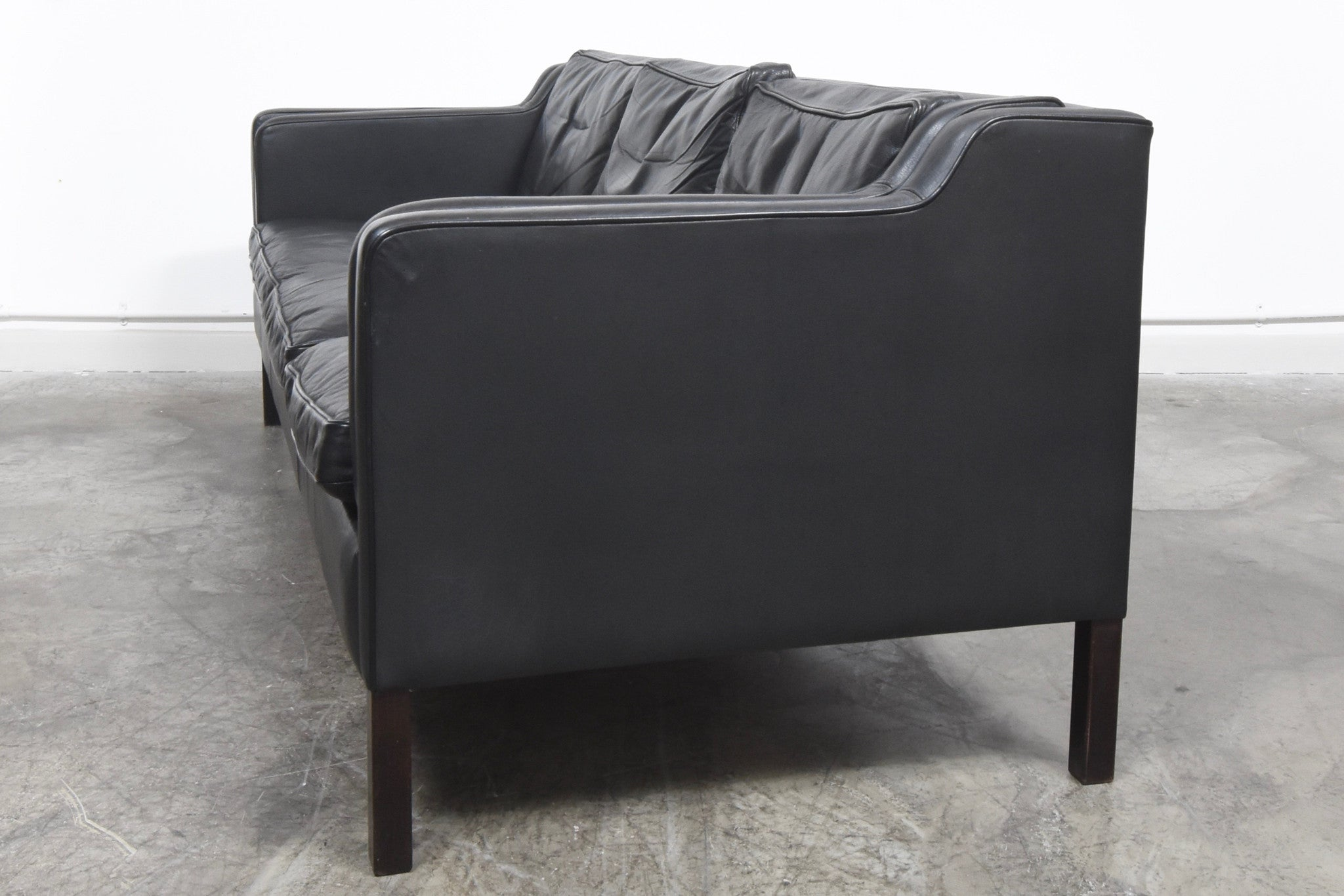 Not specified Black leather three seater by Stouby