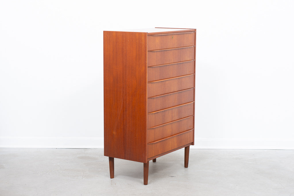 Tall chest of eight drawers in teak