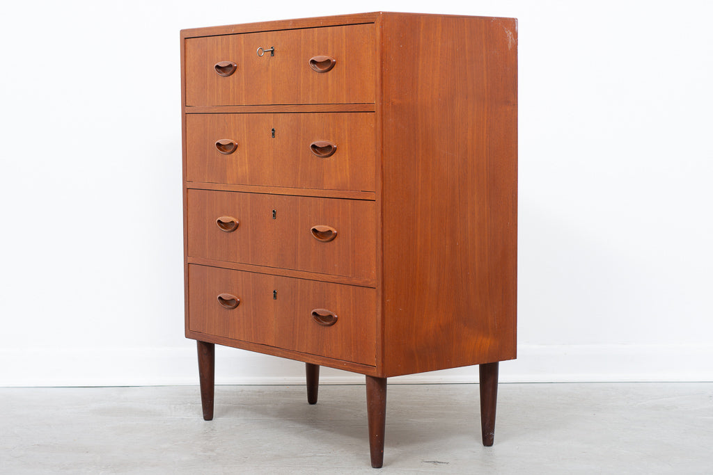 Teak chest of four drawers
