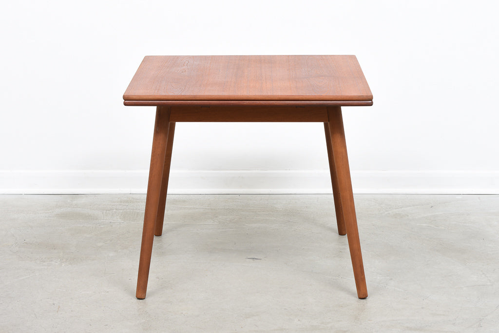 Teak extending dining table by Poul Volther
