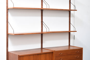 Modular shelving system in teak by P.S. Møbler