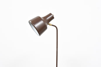Height-adjustable floor lamp on tripod base