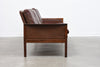 Three seat leather + rosewood sofa by Hans Olsen