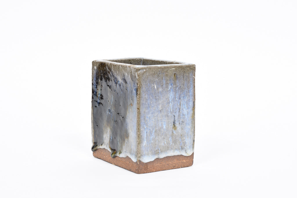 Rectangular stoneware vase with running glaze
