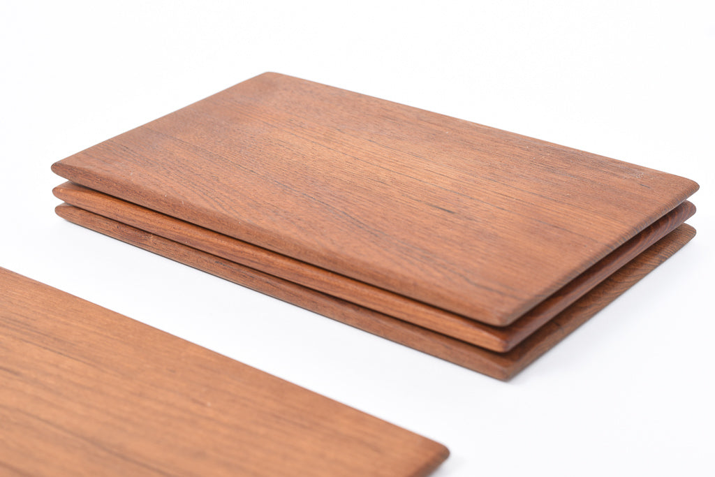 Set of four teak bread plates