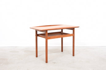 Teak coffee table with magazine rack by Grete Jalk