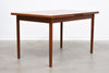 Extending dining table in teak