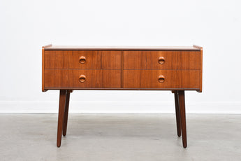 Low teak chest of drawers
