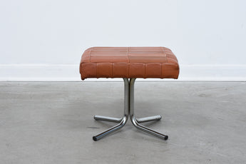 Vintage leather foot stool on metal base no. 1