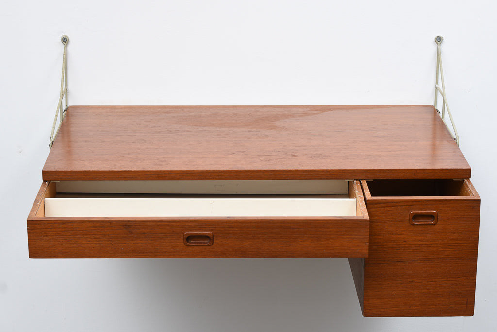 Floating desk in teak with metal wall brackets