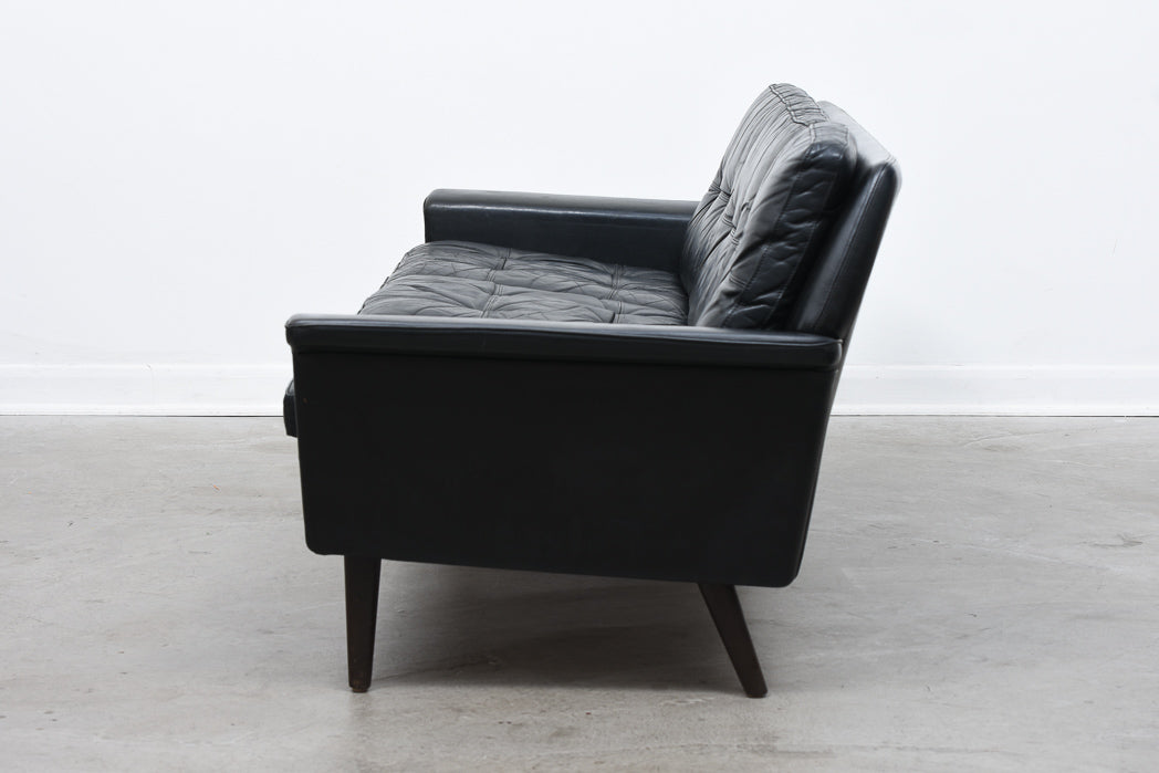 Vintage three seat sofa in black leather