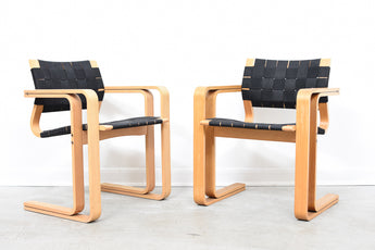 Two available: Oak armchairs by Magnus Olesen