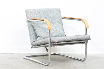 One left: Reclining steel lounge chair