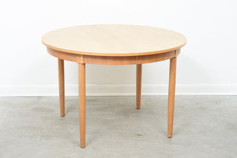 Round extending dining table in oak