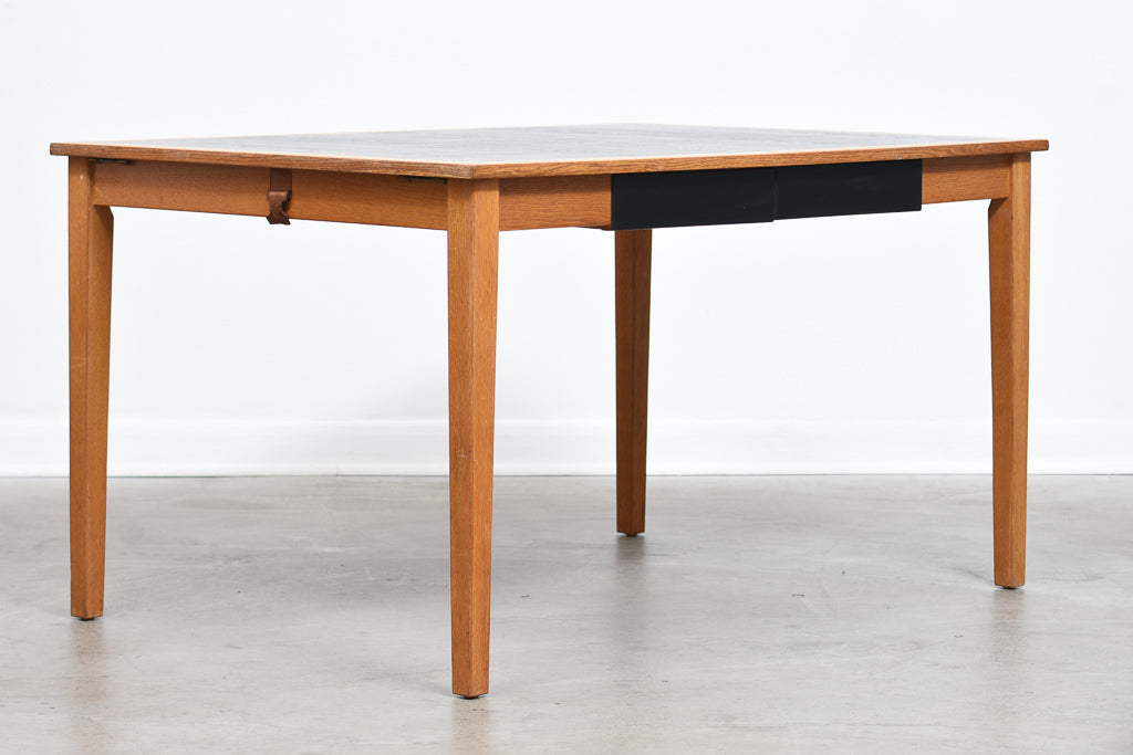 Extending oak dining table by Kai Winding