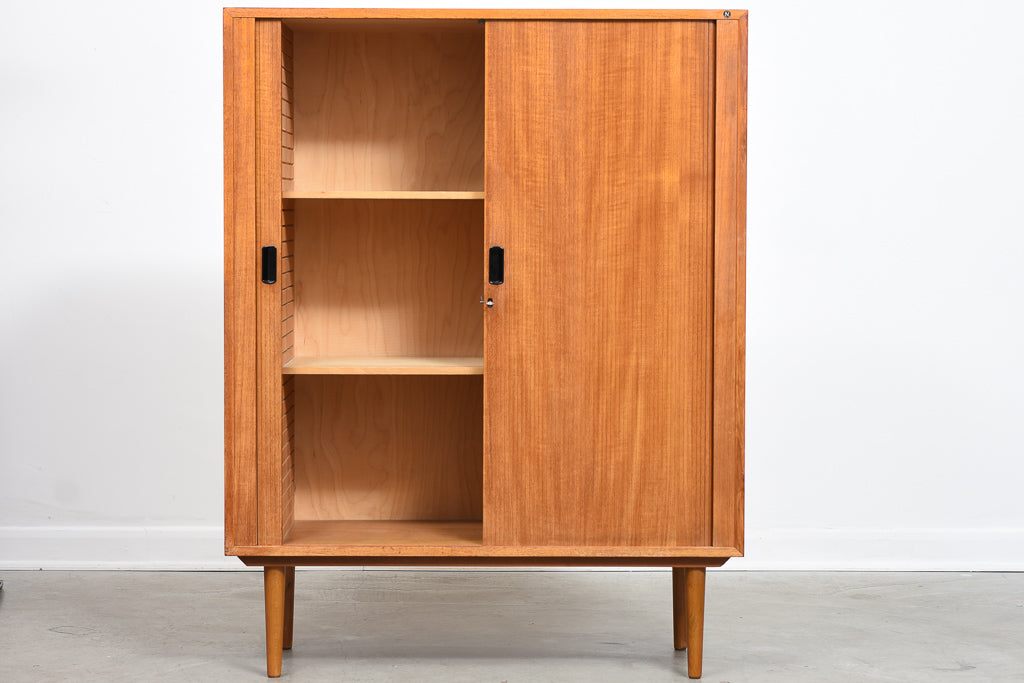 Storage cabinet in teak with tambour door