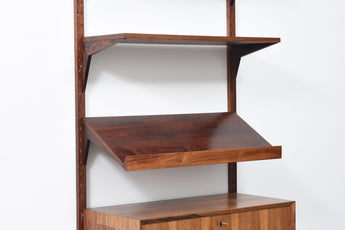 Single bay of rosewood shelving by CADO