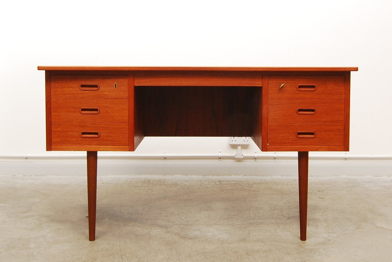 Bow fronted teak desk