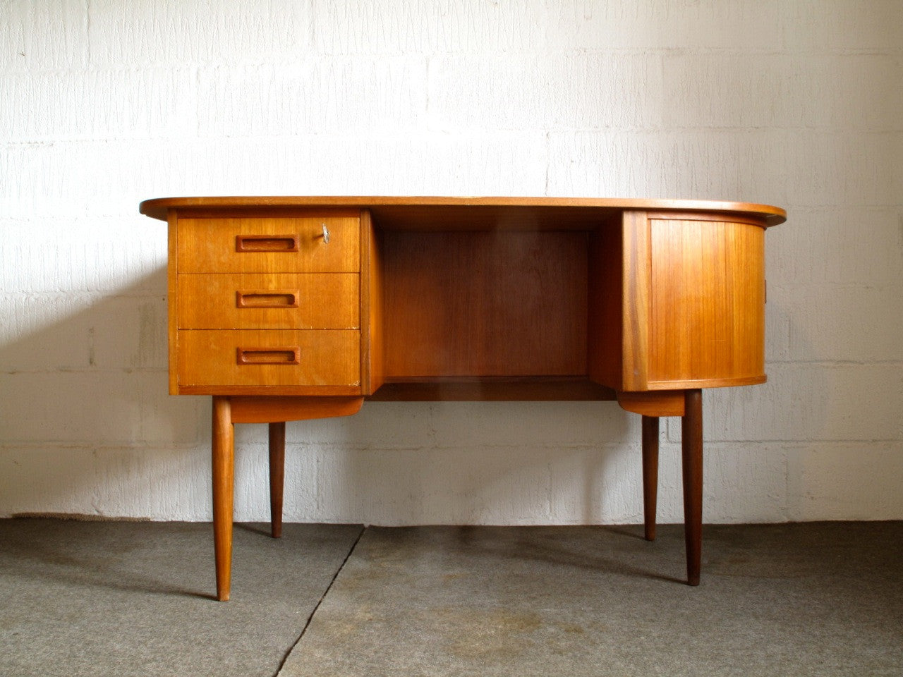 Teak desk with oblong surface