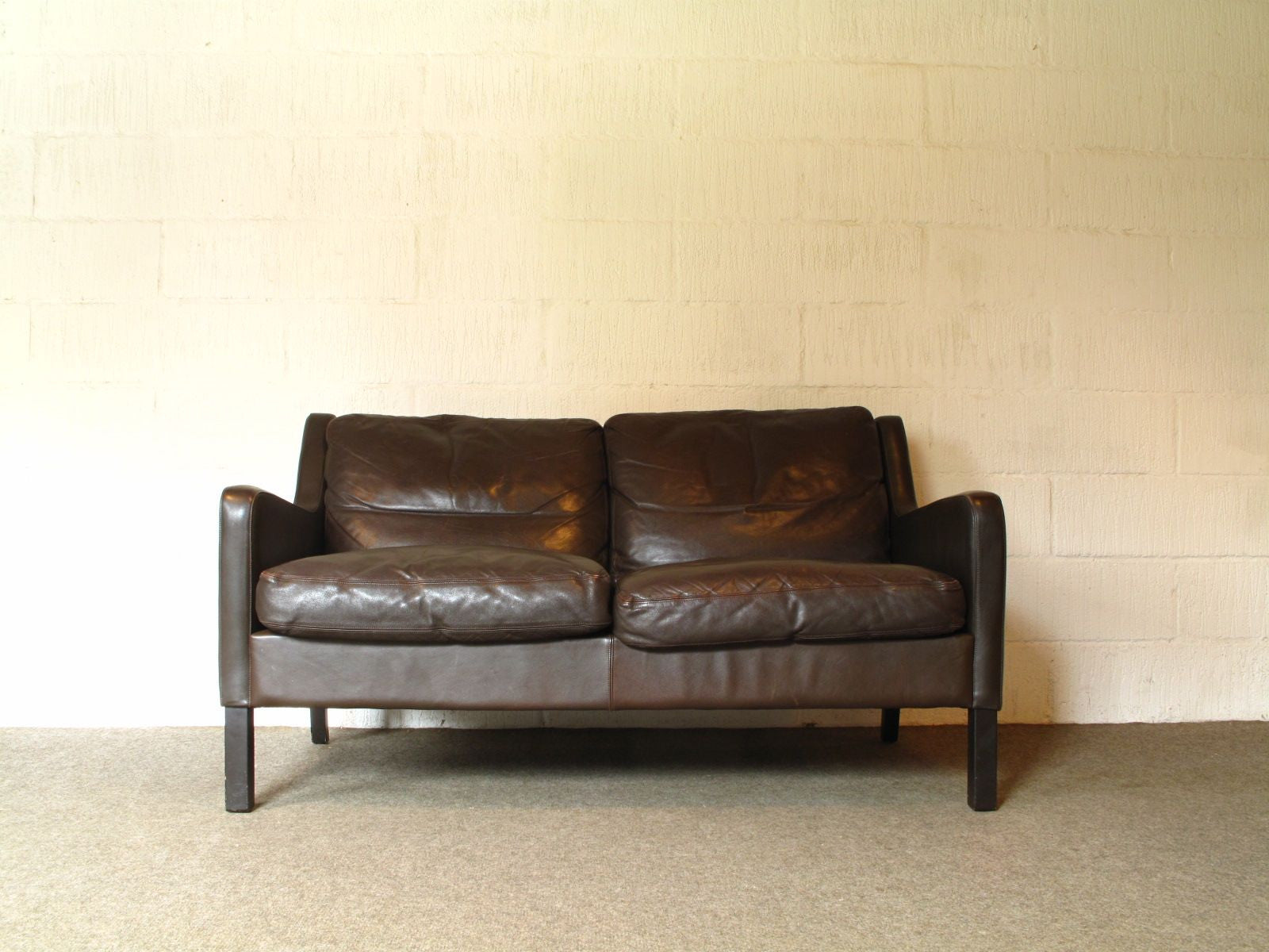 Two seat leather sofa by G. Thams