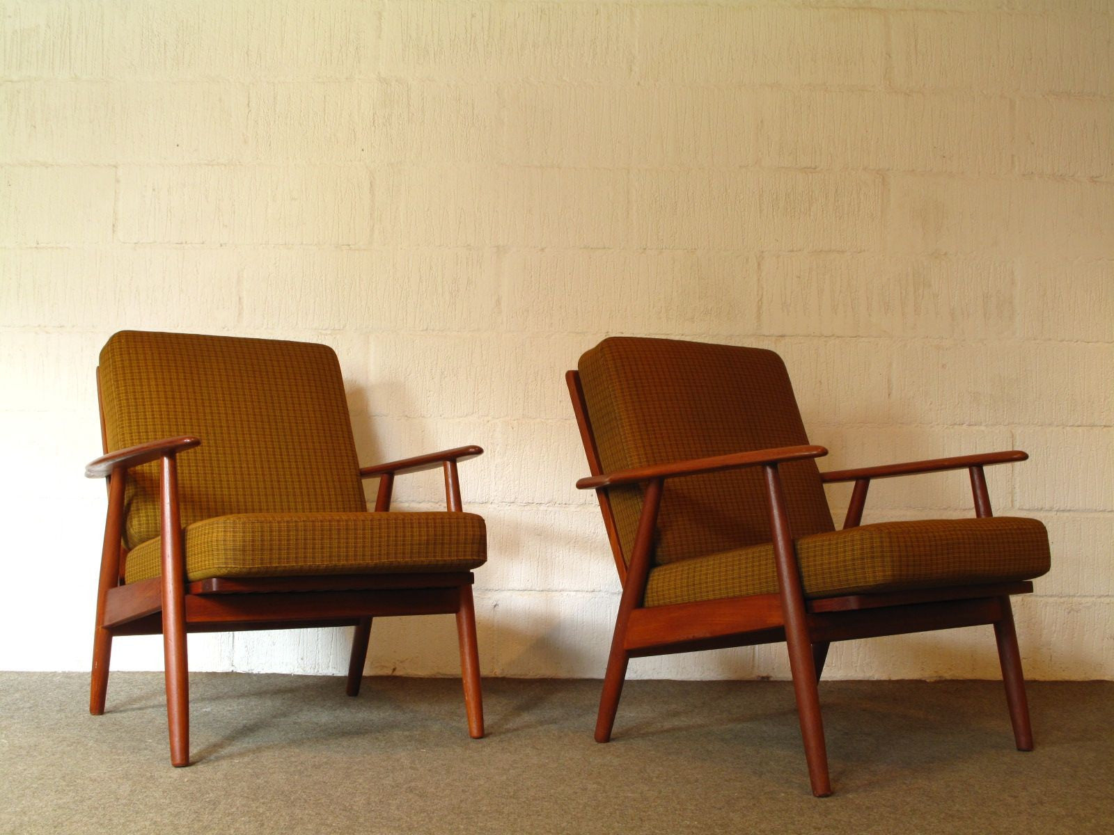 Pair of teak loungers with sprung cushions