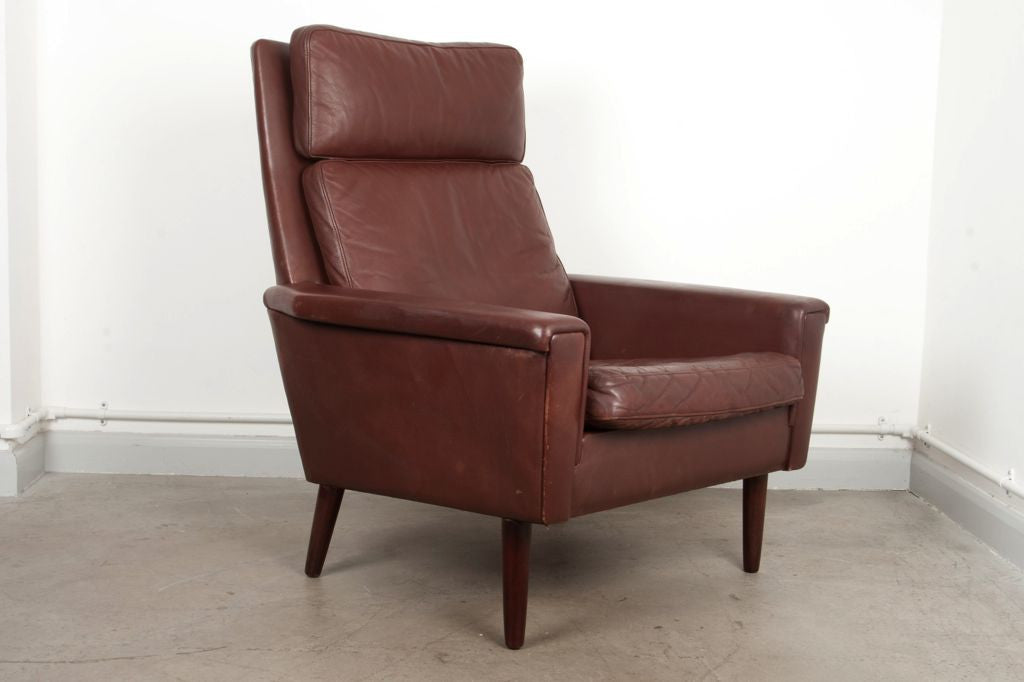 High back leather lounge chair on oak legs