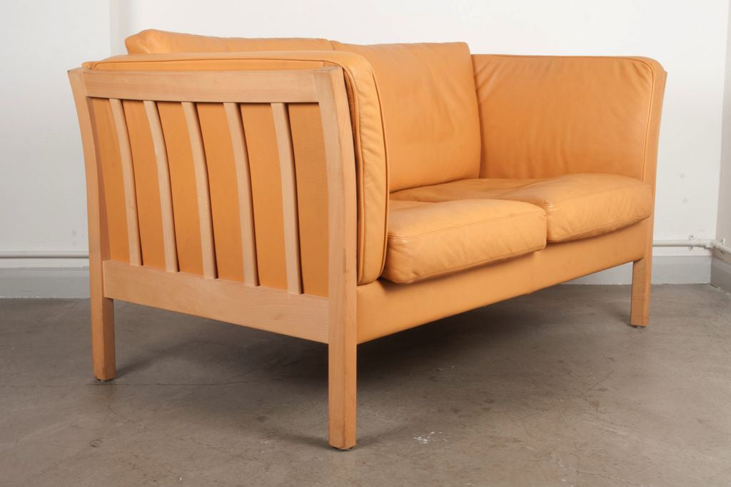 Tan leather two seater by Stouby