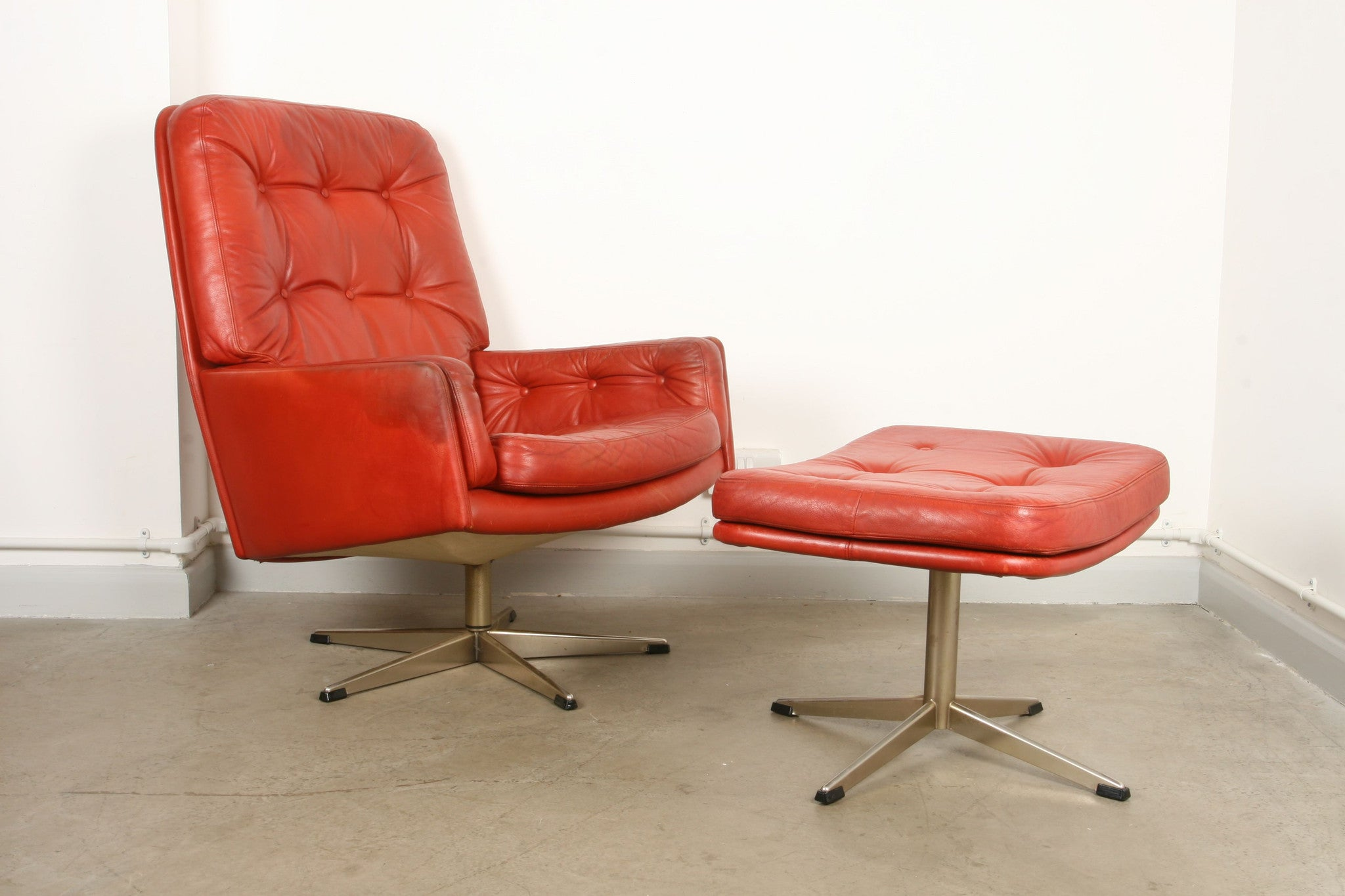 High back leather lounger with matching foot stool
