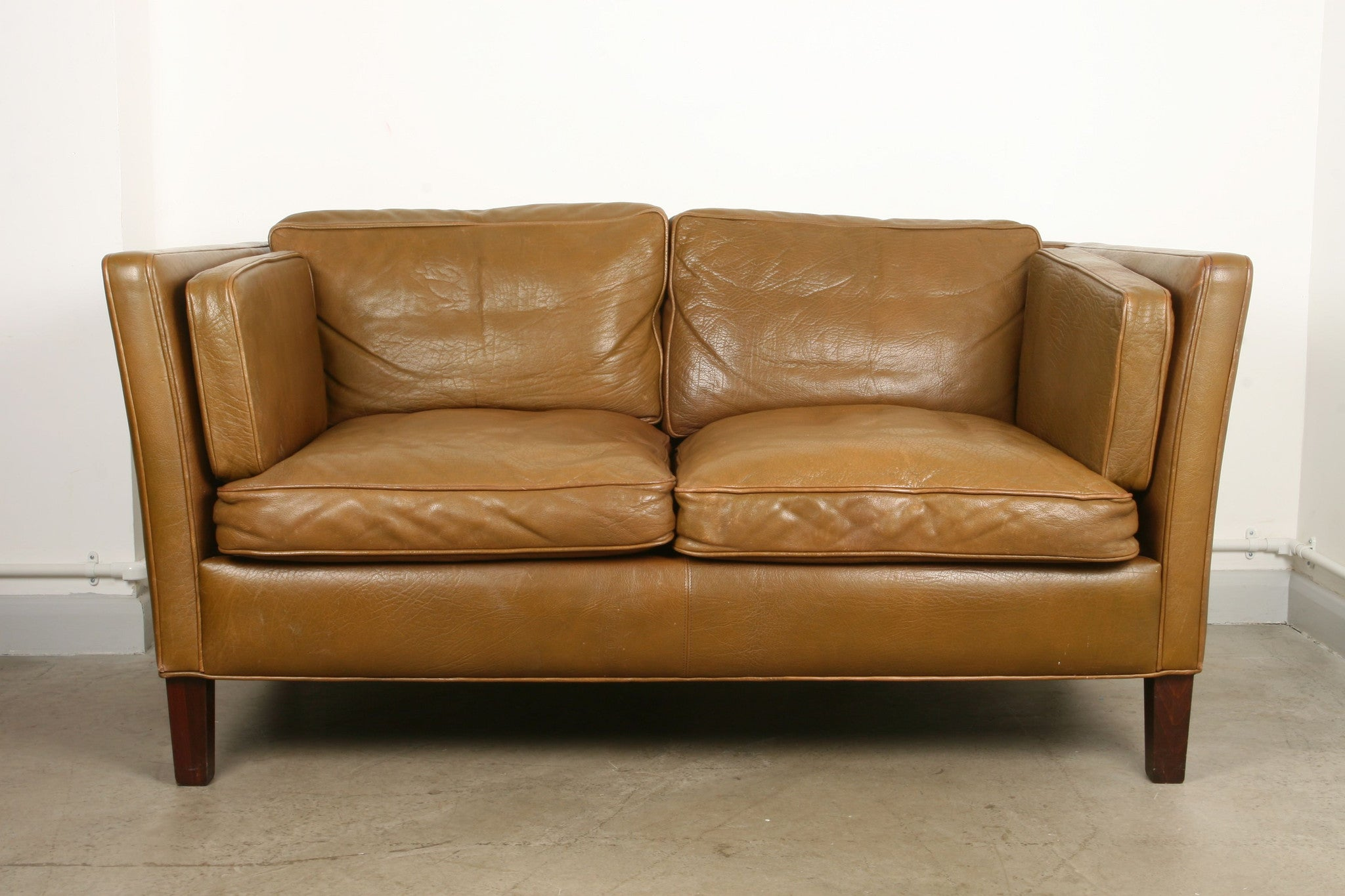 Two seat sofa in buffalo leather