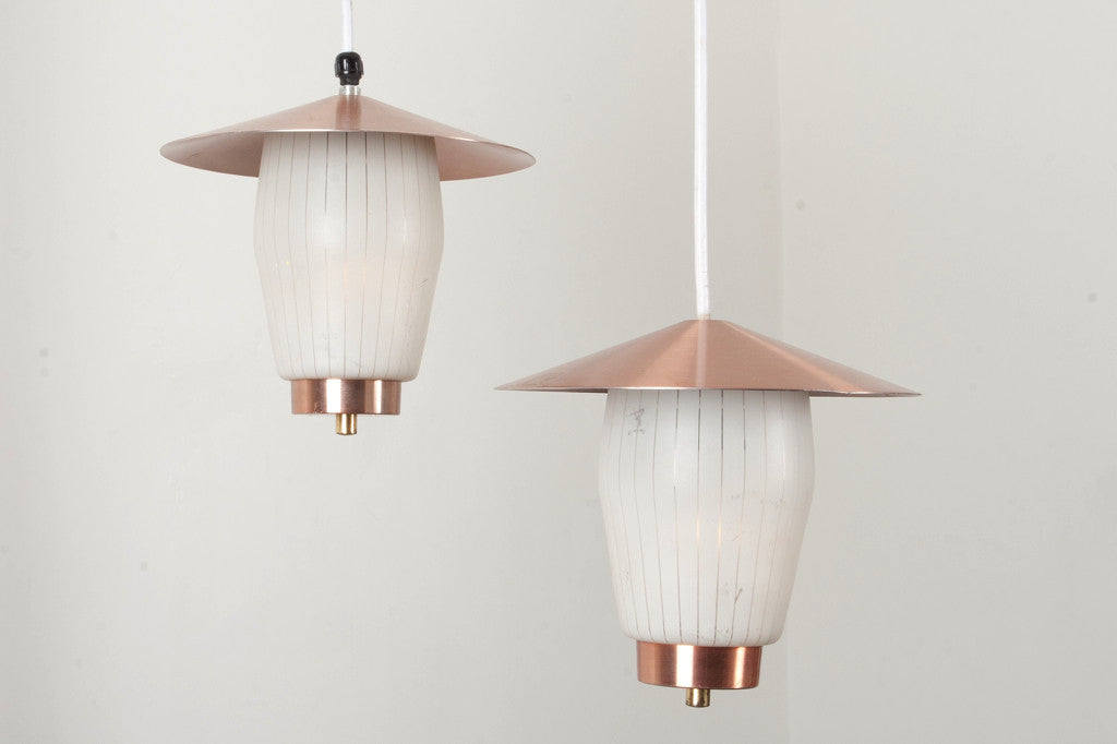 Pair of glass and brass ceiling lamps