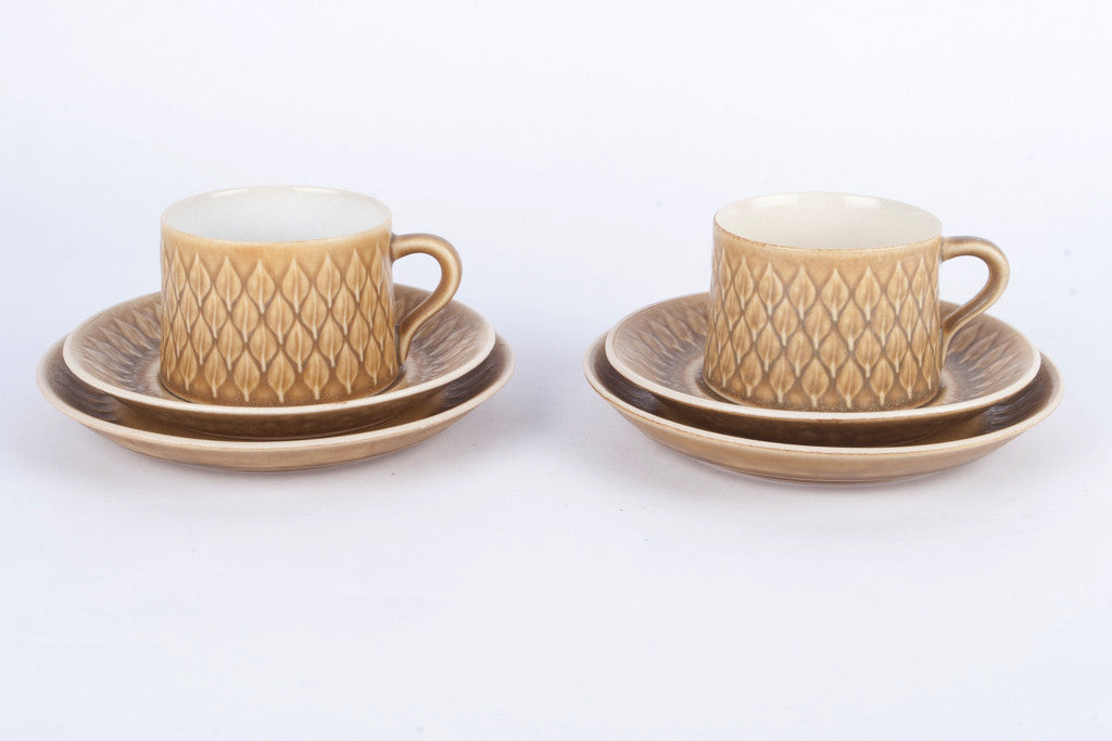 Pair of  tea cups and cake plates by Kronjyden