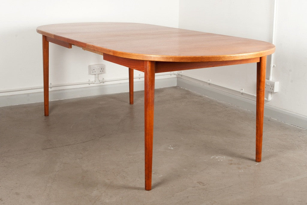 Oval shaped teak dining table by Nils Jonsson