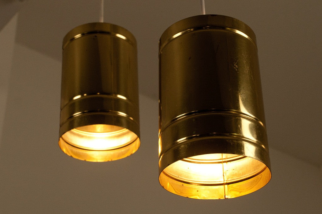 Pair of brass can lamps by David Lampe
