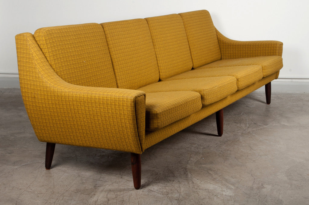Four seat wool sofa on rosewood legs