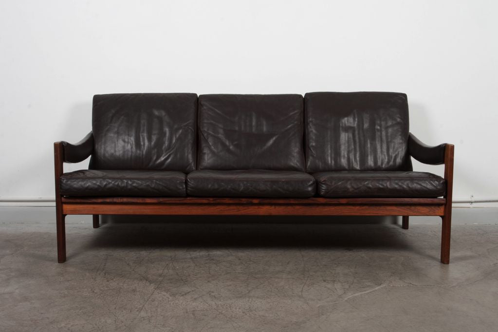 Three seat rosewood and leather sofa